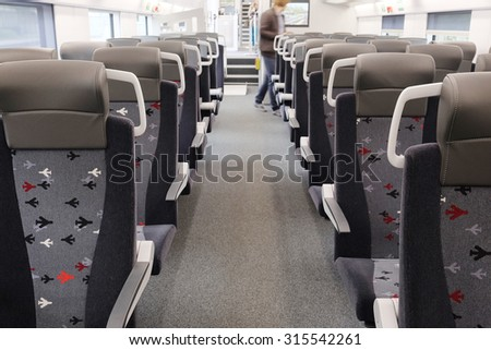 Interior of a train passenger coach - Shutterstock ID 315542261