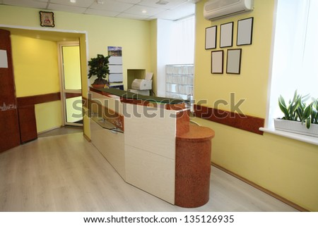 Interior of a waiting room with a table of reception