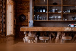 Interior of a wooden hunting lodge in the mountains