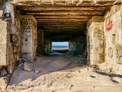 Interior of a WW2 bunker with graffiti at a French beach