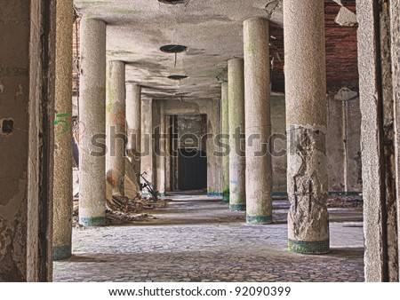 interior of abandoned building with rubble and debris - destroyed room with columns cf an old building in ruins