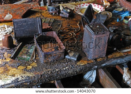 Interior of abandoned house, closeup at messy table