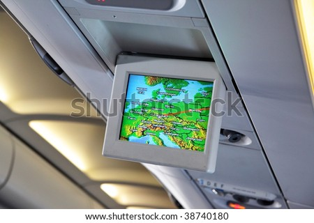 Interior of airplane with informational screen