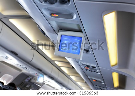 Interior of airplane with informational screens (Economy class)