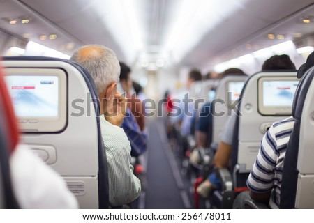 Interior of airplane with passengers on seats waiting to taik off. #256478011
