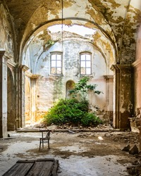 Interior of an abandoned church in Craco, a ghost town in Basilicata region abandoned due to a landslide, Italy