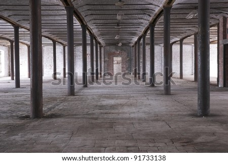 Interior of an abandoned Industrial Warehouse - stock photo