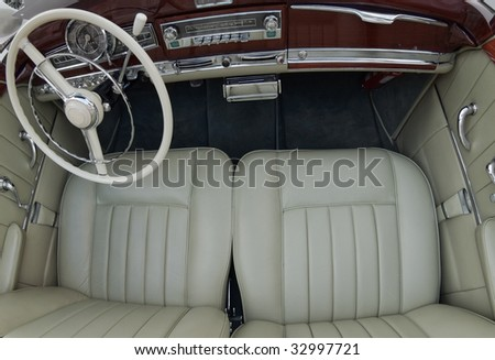 Interior of an elegant vintage car in black and white