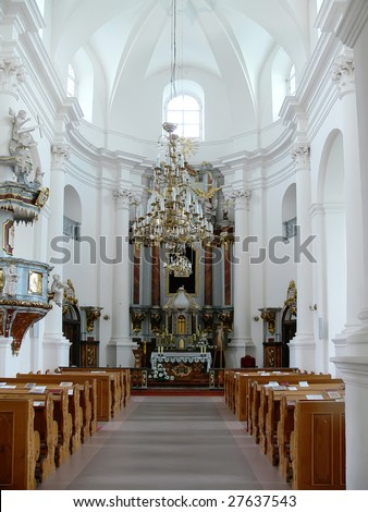 interior of an empty church with rows of benches