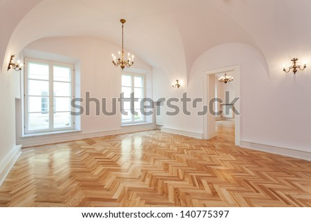 Interior of an empty palace with a wooden floor and chandelier. #140775397