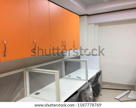 Interior of an office space, work space, desktop, cupboards and chairs #1187778769