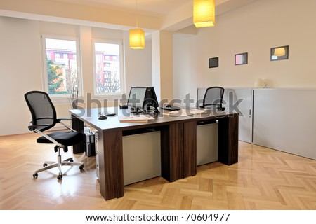 Interior of an office with two chairs