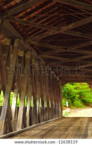 Interior of an old covered bridge in a rural setting