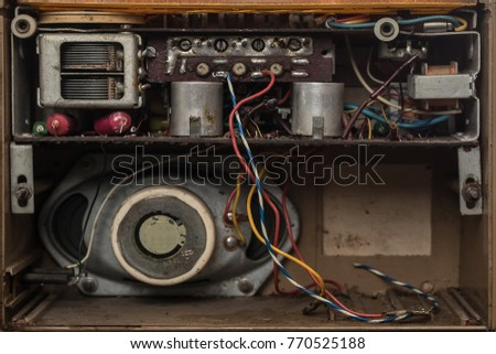 Interior of an old radio. Components of an old transistor radio from sixties or seventies. #770525188