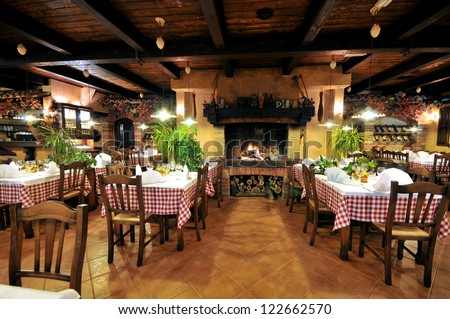 Interior of an old tavern with old wooden furniture.