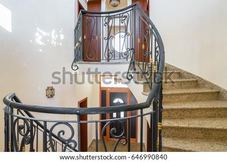 Interior of an villa, spiral staircase