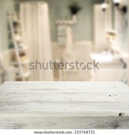 interior of bathroom in blue and white color and white table