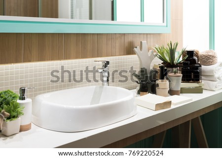 Interior of bathroom with sink basin faucet and mirror. Modern design of bathroom. - Shutterstock ID 769220524