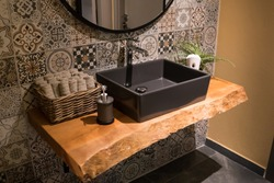 Interior of bathroom with stylish sink basin faucet. Modern design of accessory