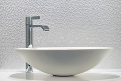 Interior of bathroom with washbasin and faucet. Bathroom interior sink with modern design.