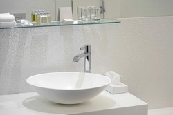 Interior of bathroom with washbasin and faucet. Bathroom interior sink with modern design in luxury hotel.