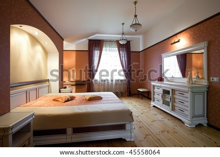 Interior Of Beautiful Bedroom With White Wooden Furnitu
