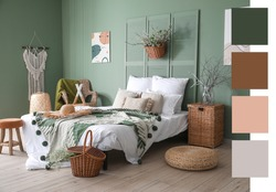 Interior of beautiful modern bedroom with spring flowers. Different color patterns