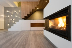 interior of beautiful modern living room with fireplace