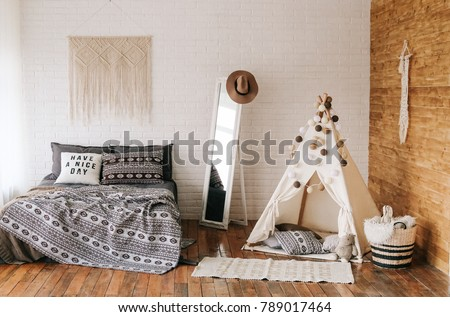 interior of bedroom with decoration bed in boho style