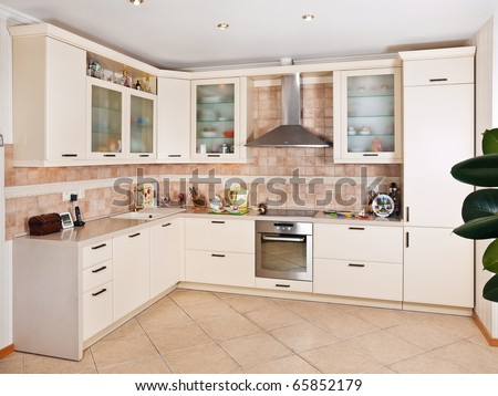 Interior of  beige kitchen in modern house - stock photo