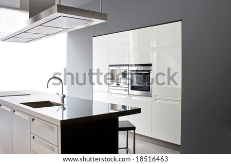Interior of big white kitchen in apartment