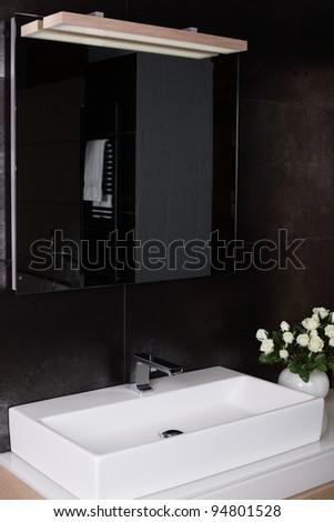 Interior of brand new bathroom with mirror