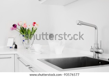 Interior of bright white kitchen