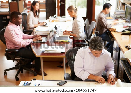 Interior Of Busy Architect's Office With Staff Working