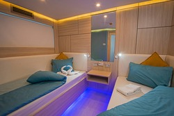 Interior of cabin bedroom on luxury sailing yacht with twin beds