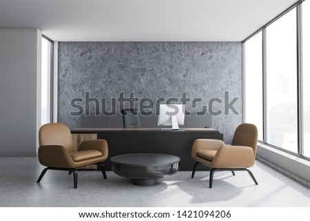 Interior of CEO office with concrete and white walls, black and wooden table with computer and coffee table with leather armchairs. 3d rendering