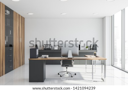 Interior of CEO office with white walls, tiled floor, gray and wooden computer desk, shelf with folders and bookcase. 3d rendering