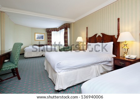 Interior of clean and tidy hotel bedroom