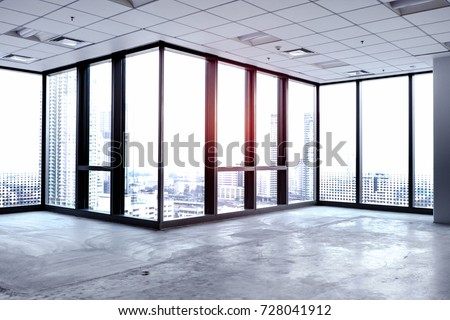 Interior of clean empty office room with white wallpaper without furniture in a new building. Big space with window view.