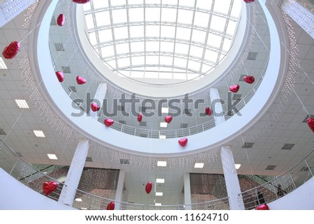 interior of commercial center, decorated with  infatable hearts