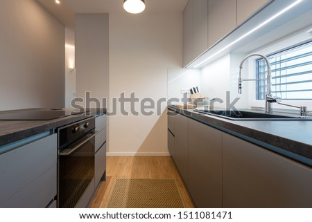 Interior of contemporary kitchen with built-in appliances #1511081471