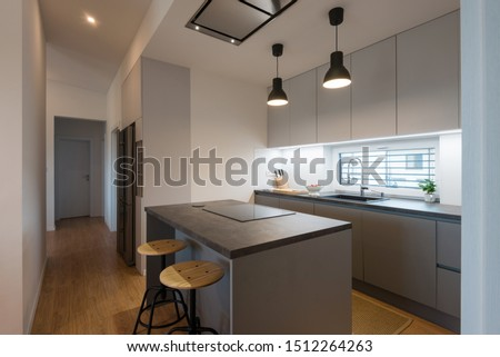 Interior of contemporary kitchen with built-in appliances #1512264263