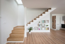 Interior of contemporary living room with wooden stairway