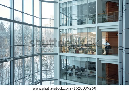 Interior of contemporary multi-floor business center with large windows and many offices in front of them Photo stock ©