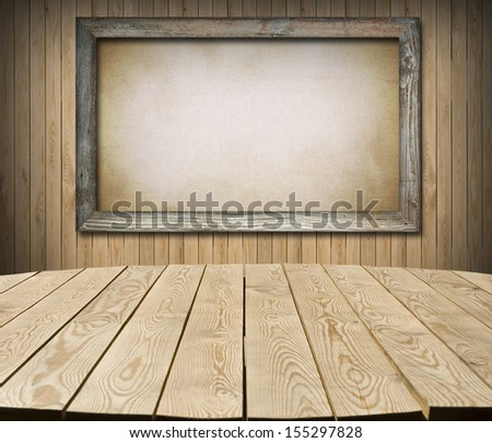 Interior of cottage room with empty tabletop and board for Your product advertisement