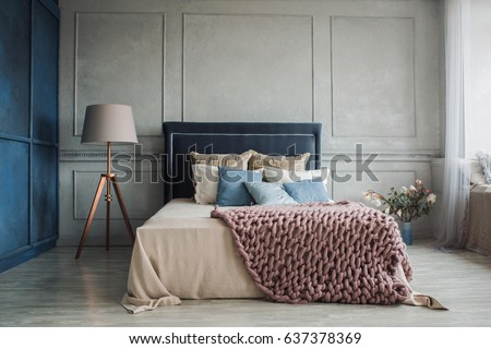 Interior of cozy bedroom in modern design with craft floor lamp