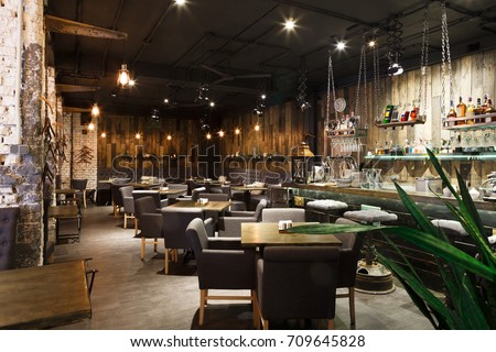 Interior of cozy restaurant. Contemporary design in loft style, modern dining place and bar counter, copy space #709645828