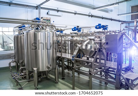 Interior of dairy factory with fermentation tank. Technology equipment at dairy farm. Sterile production.