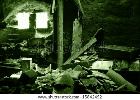 Interior of damaged abandoned house. Mess and chaos. Green toned photo.