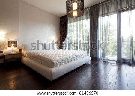 Interior of designer bedroom with beautiful view from window